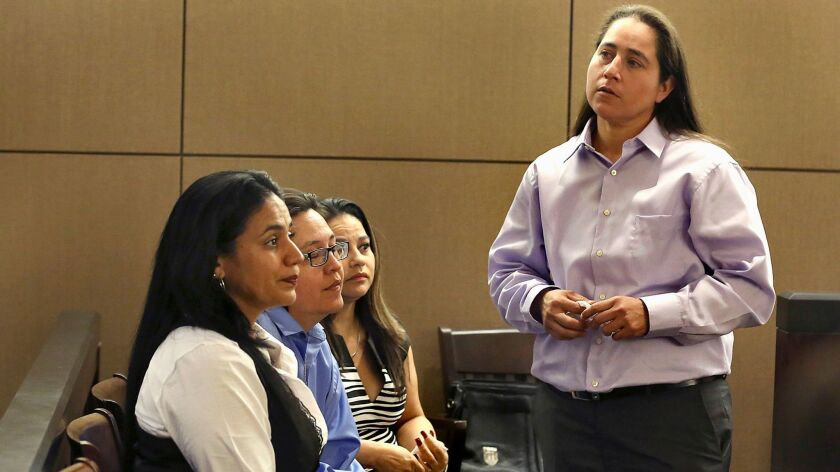 "The ""San Antonio Four,"" from right, Anna Vasquez, Elizabeth Ramirez, Kristie Mayhugh and Cassandra Rivera, attend a hearing in 2015."