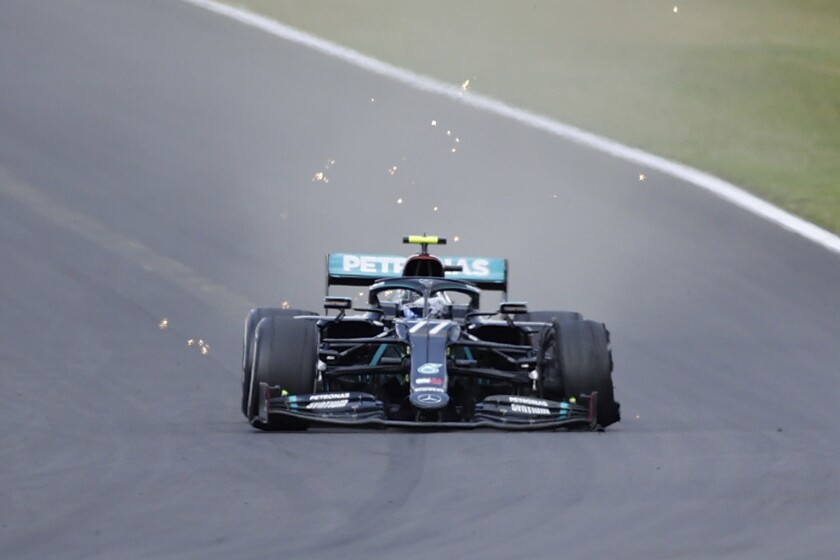Mercedes driver Valtteri Bottas of Finland steers his car with a flat tire during the British Formula One Grand Prix at the Silverstone racetrack, Silverstone, England, Sunday, Aug. 2, 2020. (Andrew Boyers/Pool via AP)