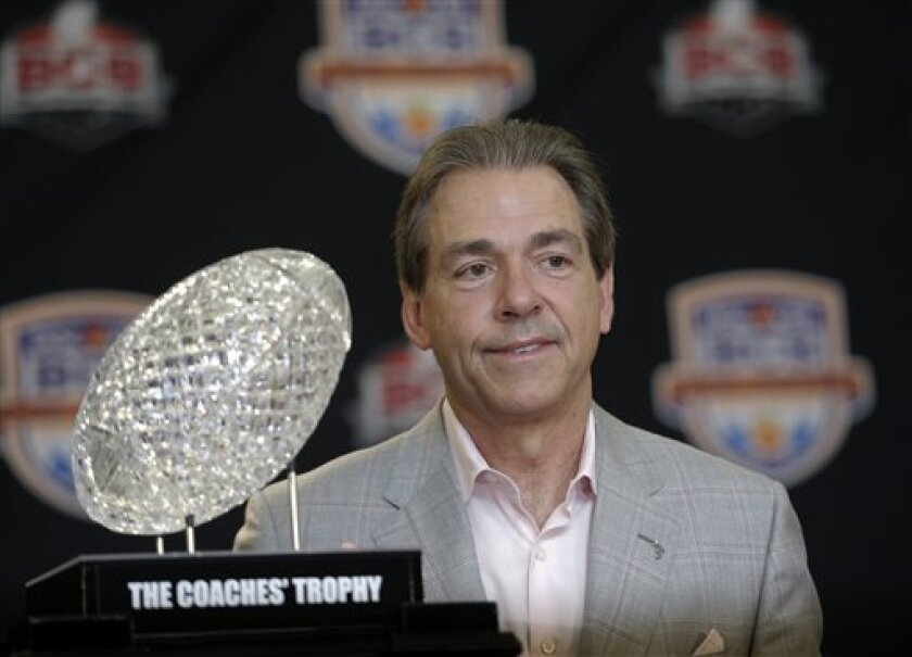 FILE -In a Jan. 8, 2013 file photo Alabama head coach Nick Saban poses with The Coaches' Trophy during a BCS National Championship college football game news conference  in Ft. Lauderdale, Fla. By the time Dylan Moses is old enough to play football at Alabama, Nick Saban would be 65 and starting hi