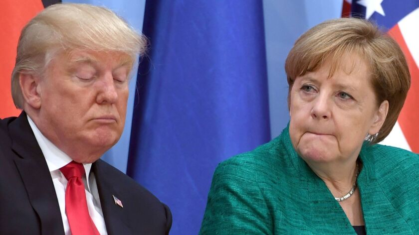 U.S. president Donald Trump, left, and German chancellor Angela Merkel attend the Women's Entrepre