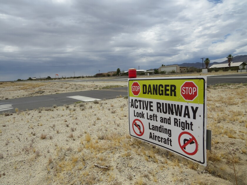 Residents of the Borrego Air Ranch community must drive over a runway to get to some of their homes