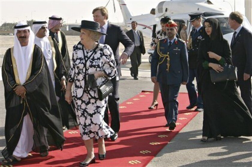In this handout photo dated Tuesday Jan. 10, 2012 and made available by DP World, Queen Beatrix of the Netherlands, front right, and Willem Prince of Orange, directly behind the Queen, and Sultan Ahmed Bin Sulayem, Chairman, DP World, 1st left, visit the Jebel Ali port in Dubai, United Arab Emirates. (AP Photo/DP World, Ho)