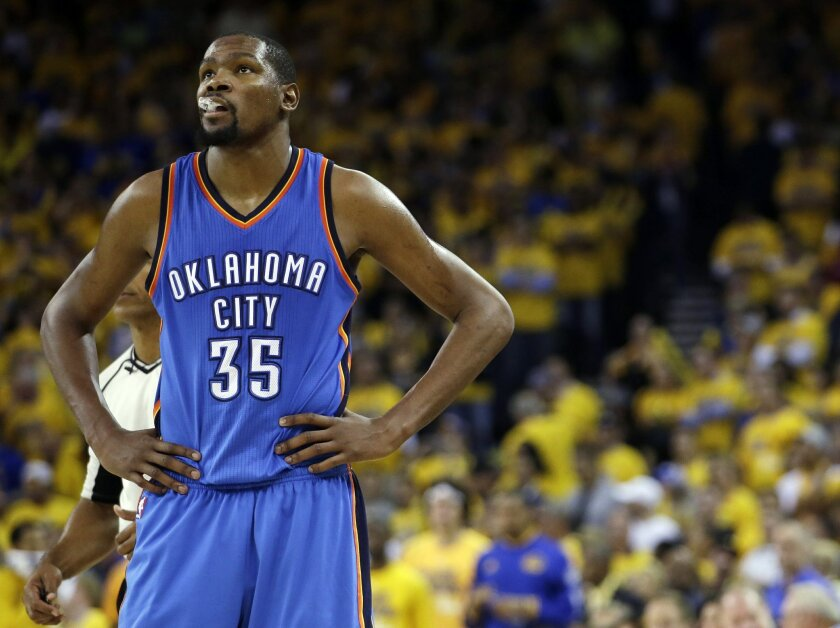 FILE - In this May 26, 2016, file photo, Oklahoma City Thunder's Kevin Durant watches during the closing minutes of the second half in Game 5 of the NBA basketball Western Conference finals against the Golden State Warriors in Oakland, Calif. Durant may not be ready to talk about his free agency ye