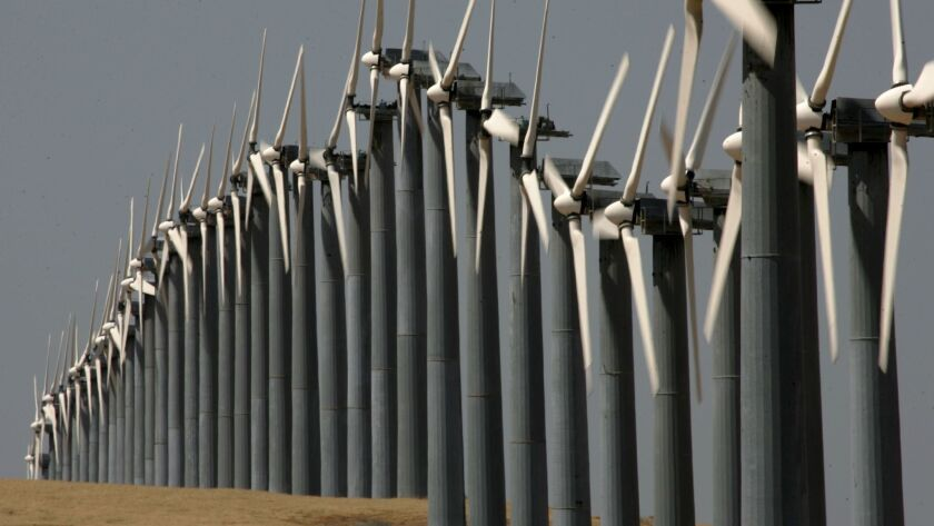 Rows of wind turbines are seen at the Altamont Pass wind farm in Byron, Calif. The House tax bill proposed cutting a tax credit used by the wind-power industry, but a compromise bill keeps the current credit in place.