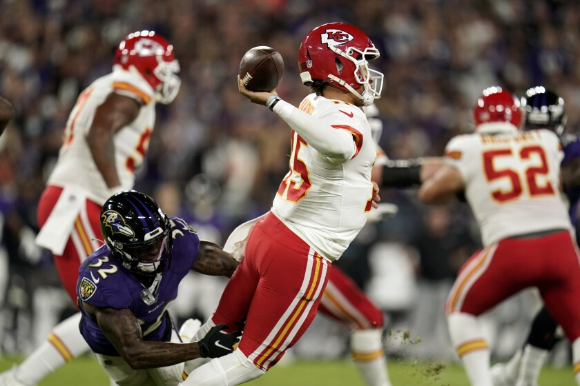 Kansas City Chiefs quarterback Patrick Mahomes attempts to throw a pass as he is pressured by Baltimore Ravens defensive back DeShon Elliott in the first half of an NFL football game, Sunday, Sept. 19, 2021, in Baltimore. (AP Photo/Julio Cortez)
