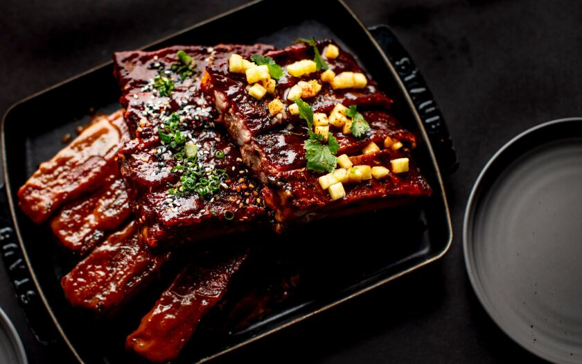 "The smoked St. Louis cut pork ribs at International Smoke come in three preparations, St. Louis-style American barbecue, Mexican style golden garlic sweet and sour, and Korean sesame gochujang. ""You wouldn't believe how many ribs we go through,"" said chef-owner Michael Mina."