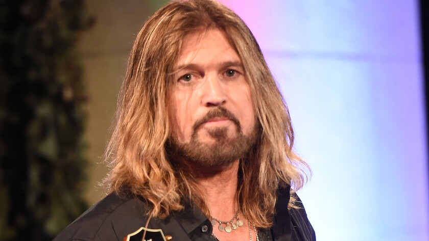 Billy Ray Cyrus appears to have Patrick Schwarzenegger's back after his daughter Miley Cyrus' boyfriend ran into some public embarrassment over vacation photos.