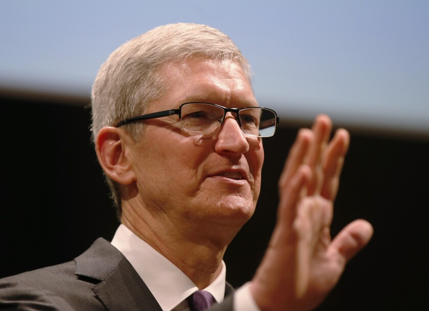 Apple CEO Tim Cook speaks in Milan, Italy, on Nov. 15. Cook has vowed to fight a court order compelling the tech company to help the FBI defeat security measures on a phone belonging to the San Bernardino shooters.