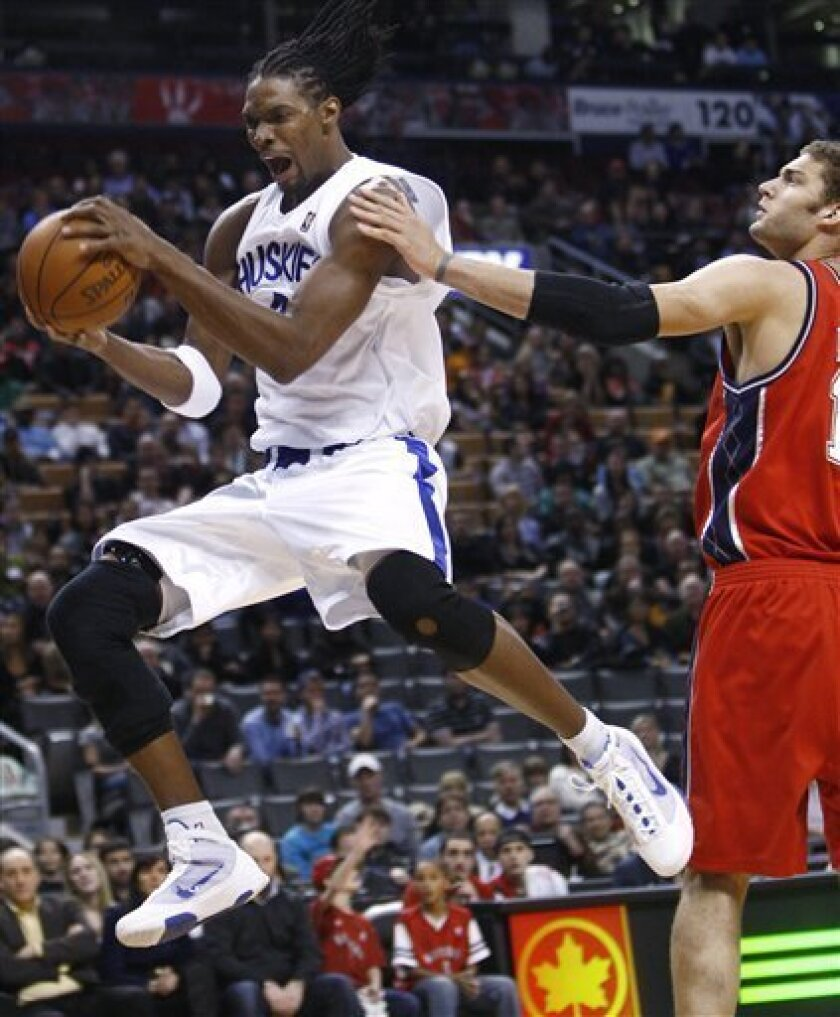 buy online 460c7 1be28 Johnson, Bosh lead Raptors past struggling Nets - The San ...