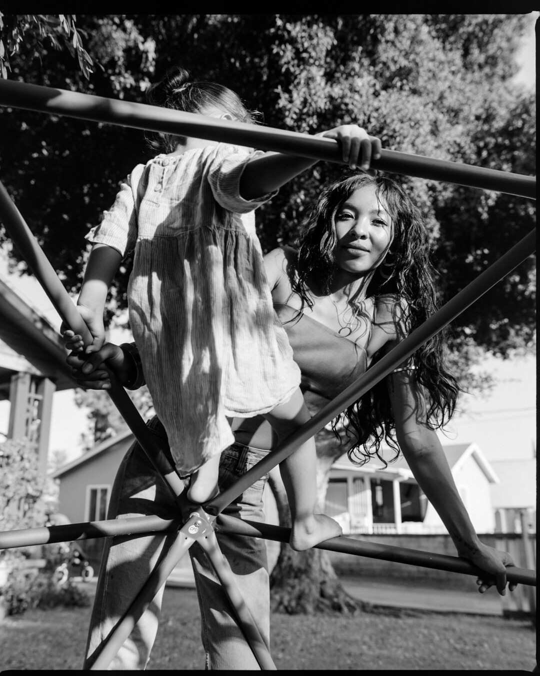 Synmia and her daughter on a jungle gym