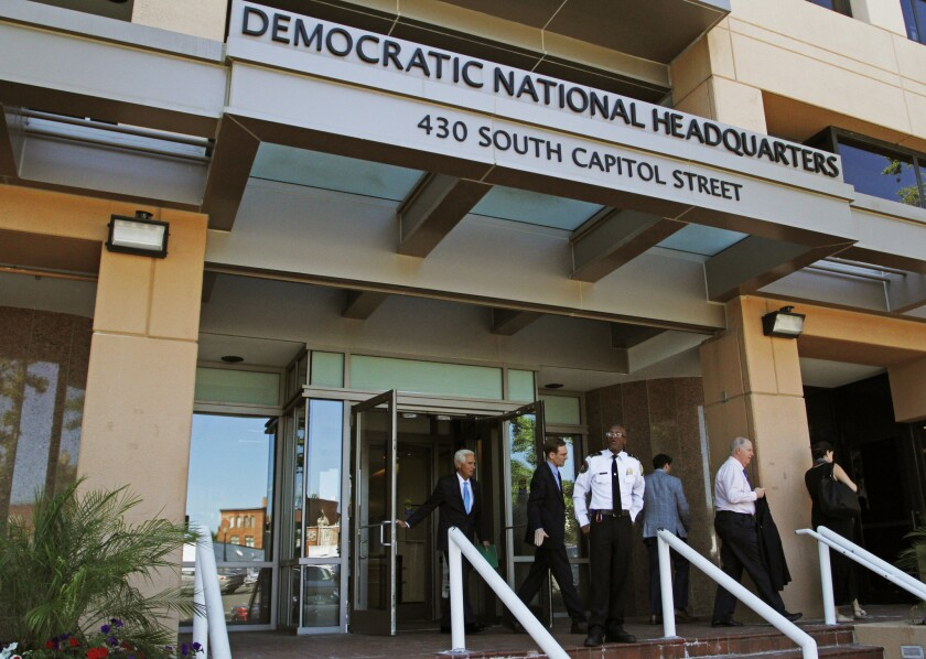 People stand outside the Democratic National Committee headquarters in Washington, D.C., in June.
