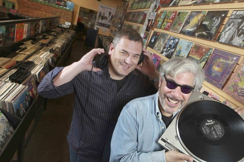 """""""Record Store Days"""" co-authors Phil Gallo, left, and Gary Calamar visit Freakbeat Records in Sherman Oaks."""