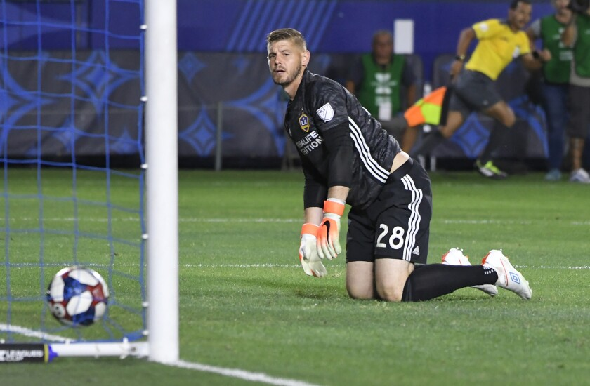 CARSON, CA - AUGUST 20: Matt Lampson #28 of Los Angeles Galaxy looks back at a goal scored by Cruz Azul in the first half at Dignity Health Sports Park on August 20, 2019 in Carson, California. (Photo by John McCoy/Getty Images) ** OUTS - ELSENT, FPG, CM - OUTS * NM, PH, VA if sourced by CT, LA or MoD **