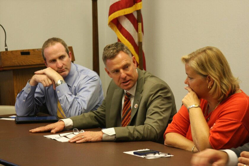 Congressmember Scott Peters (center) engages in bipartisan discussions in Washington, D.C.