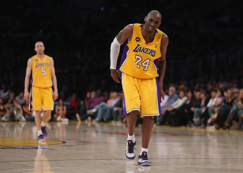 Kobe Bryant grimaces after injuring his leg in the third quarter of the Lakers' win over Golden State at Staples Center on Friday night.