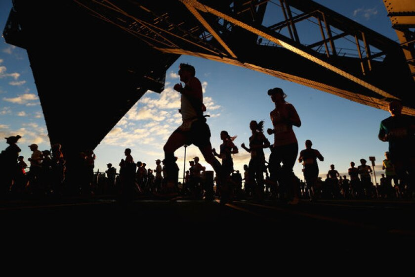 Women are drawn to half-marathons because the gear is basic and the focus is on results, says Jeff Galloway. A record 1.1 million women completed them in 2012.
