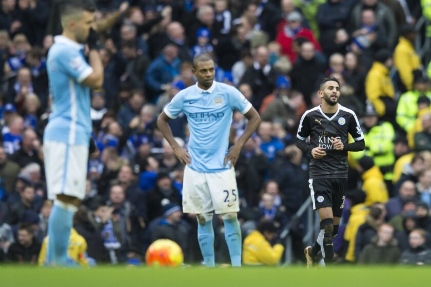 Leicester City's Riyad Mahrez, right, retakes his position after scoring his side's second goal during the English Premier League soccer match between Manchester City and Leicester City at the Etihad Stadium in Manchester, England, Saturday Feb. 6, 2016. (AP Photo/Jon Super)