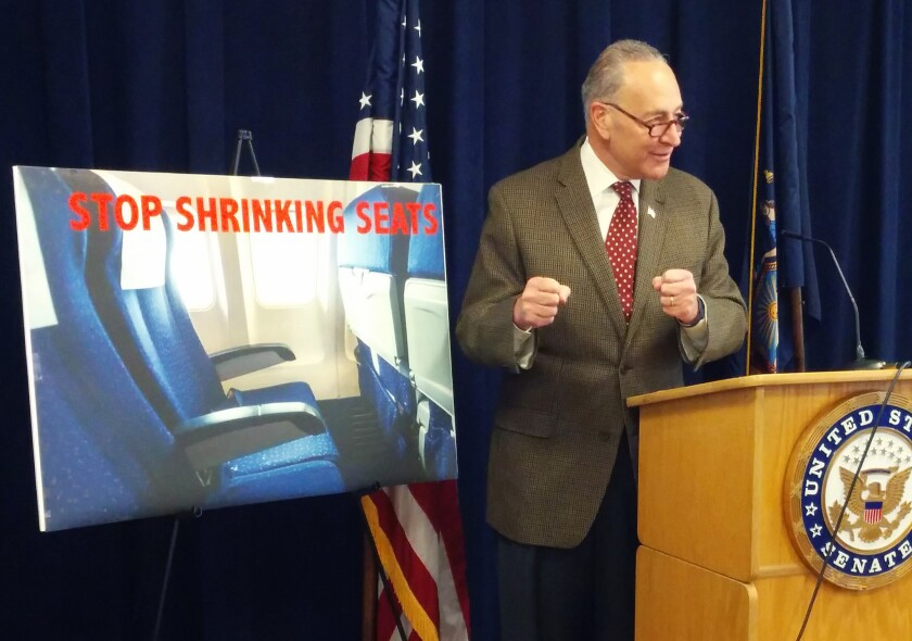 Sen. Charles E. Schumer (D-N.Y.) talks at a news conference about wanting to require the Federal Aviation Administration to establish seat-size standards for commercial airlines.