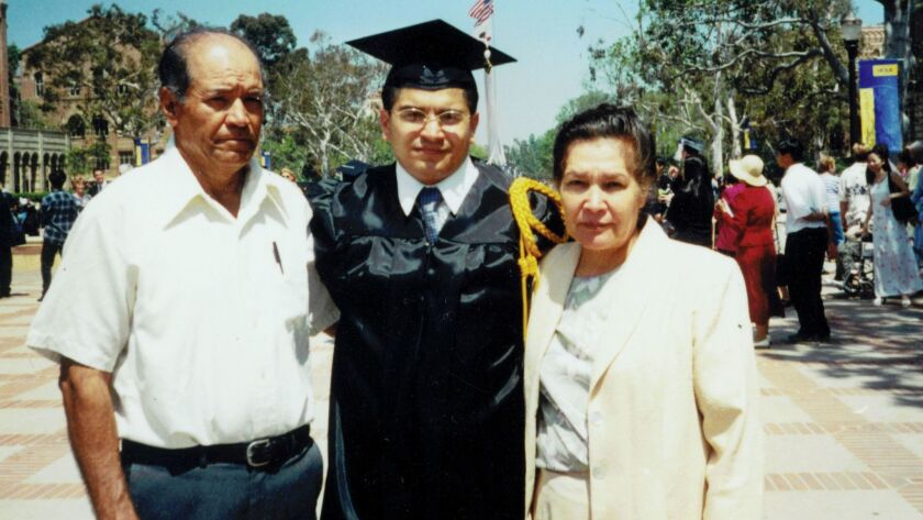 Assemblyman Jimmy Gomez, center, with his parents at his graduation from UCLA.