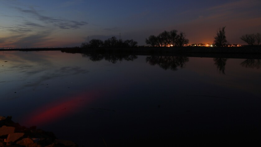 Ssunset is reflected in the Middle River in the Sacramento-San Joaquin Delta.