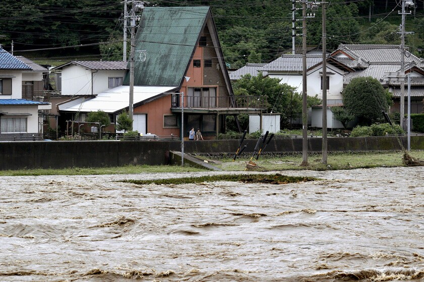 The swollen Hida River following heavy rain July 8 in the Japanese city of Gero.