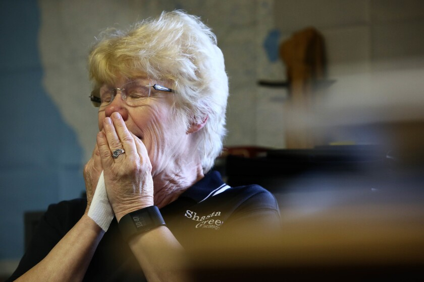 Dianne Franklin, 71, owner of logging company Shasta Green Inc., cries when talking about what will happen to her employees if a neighboring biomass plant closes.