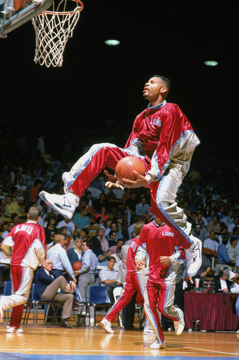 Loyola Marymount's Hank Gathers drives for a through-the-legs layup during warmups in 1990.