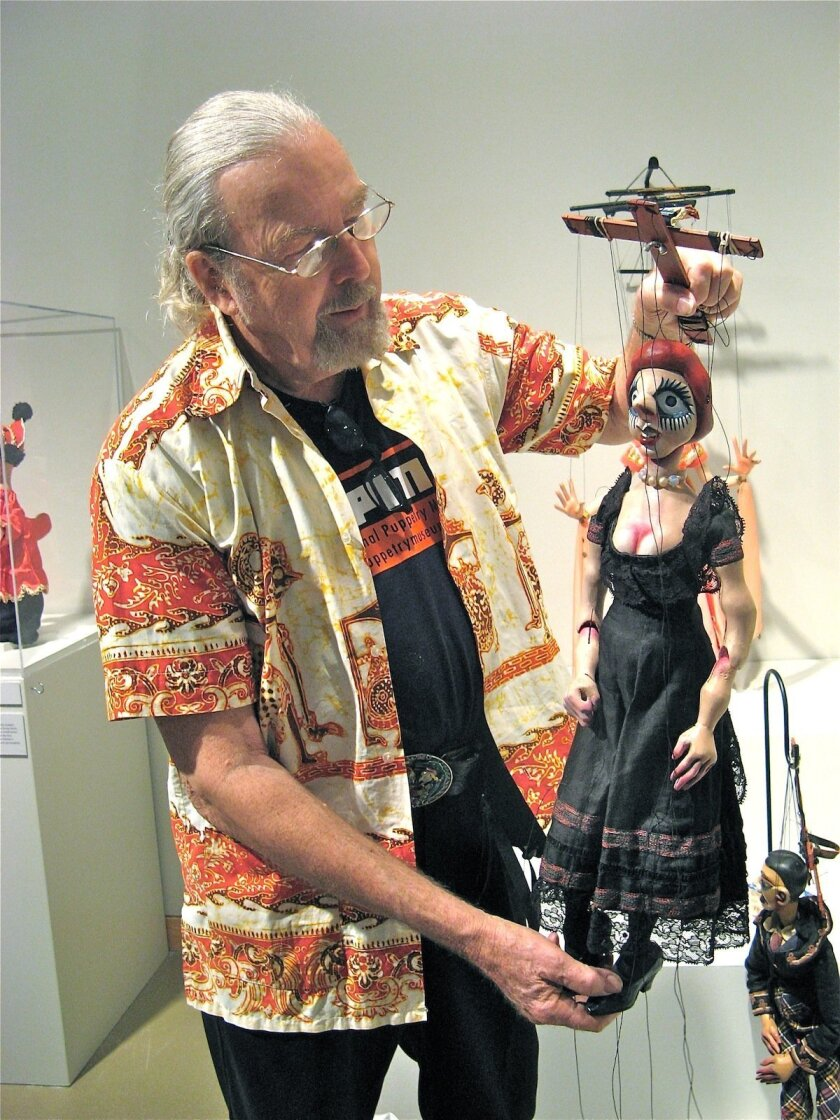 Alan Cook poses with Elena Ivanova Papova, a Chekhov play puppet made in the 1920s, one of more than 200 puppets from the Cook Collection on display at Carlsbad's Cannon Gallery. Photos by Lonnie Burstein Hewitt