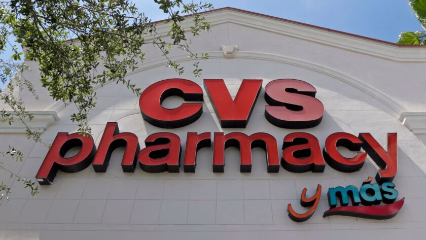 FILE - This May 15, 2017, file photo, shows a CVS pharmacy sign at a store in Hialeah, Fla. CVS will