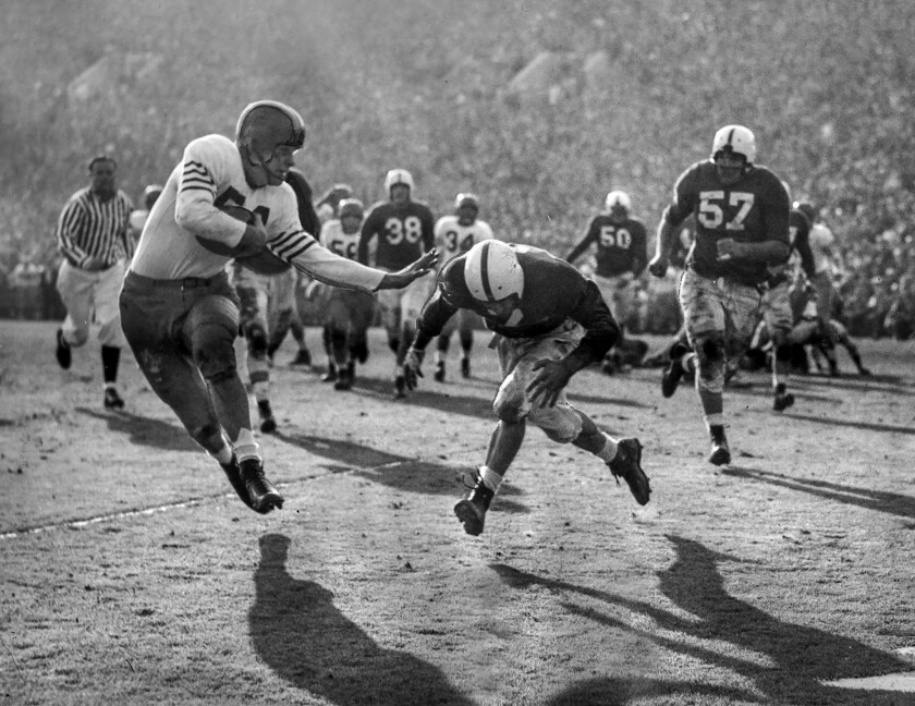 Jan. 1, 1947: The UCLA Bruins' Al Hoisch tries to tackle Illinois' Art Dufelmeier during the 1947 Rose Bowl game.