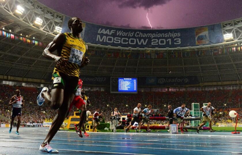 See the photo: Lightning bolt strikes as Usain Bolt wins world title