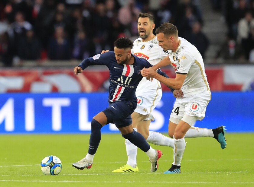 PSG's Neymar, left, and Angers' Romain Thomas battle for the ballduring French League One soccer match between PSG and Angers at the Parc des Princes stadium in Paris, Saturday, Oct. 5, 2019. (AP Photo/Michel Euler)