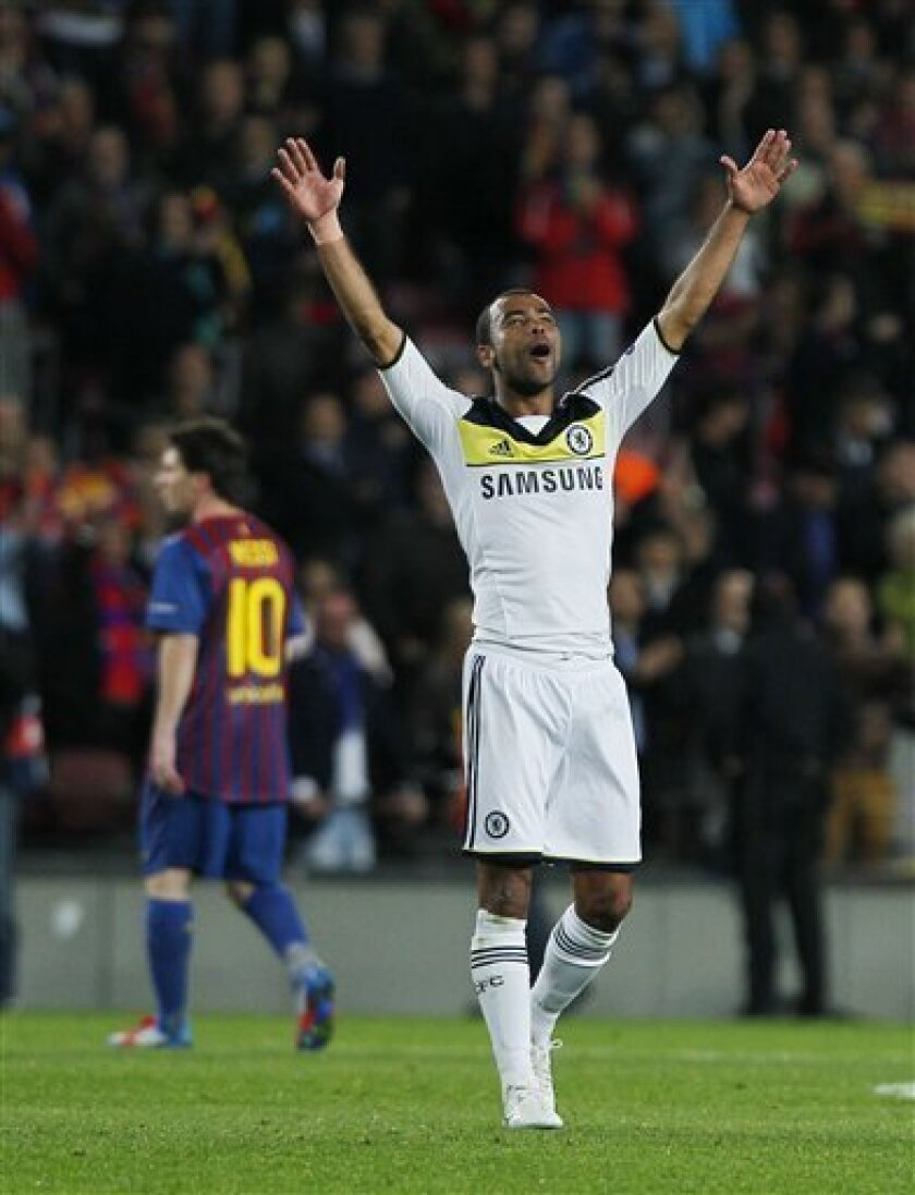 Chelsea's Ashley Cole, right, celebrates besides Barcelona's Lionel Messi from Argentina, left, during a Champions League second leg semifinal soccer match at Camp Nou stadium, in Barcelona, Spain, Tuesday, April 24, 2012. (AP Photo/Andres Kudacki)