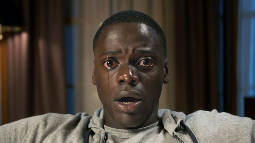"This image released by Universal Pictures shows Daniel Kaluuya in a scene from, ""Get Out."" The film"