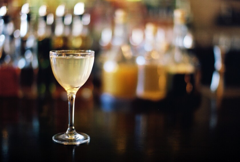 The martini at the Normandie Club is made with vodka, fino sherry, raw white honey and del gris.