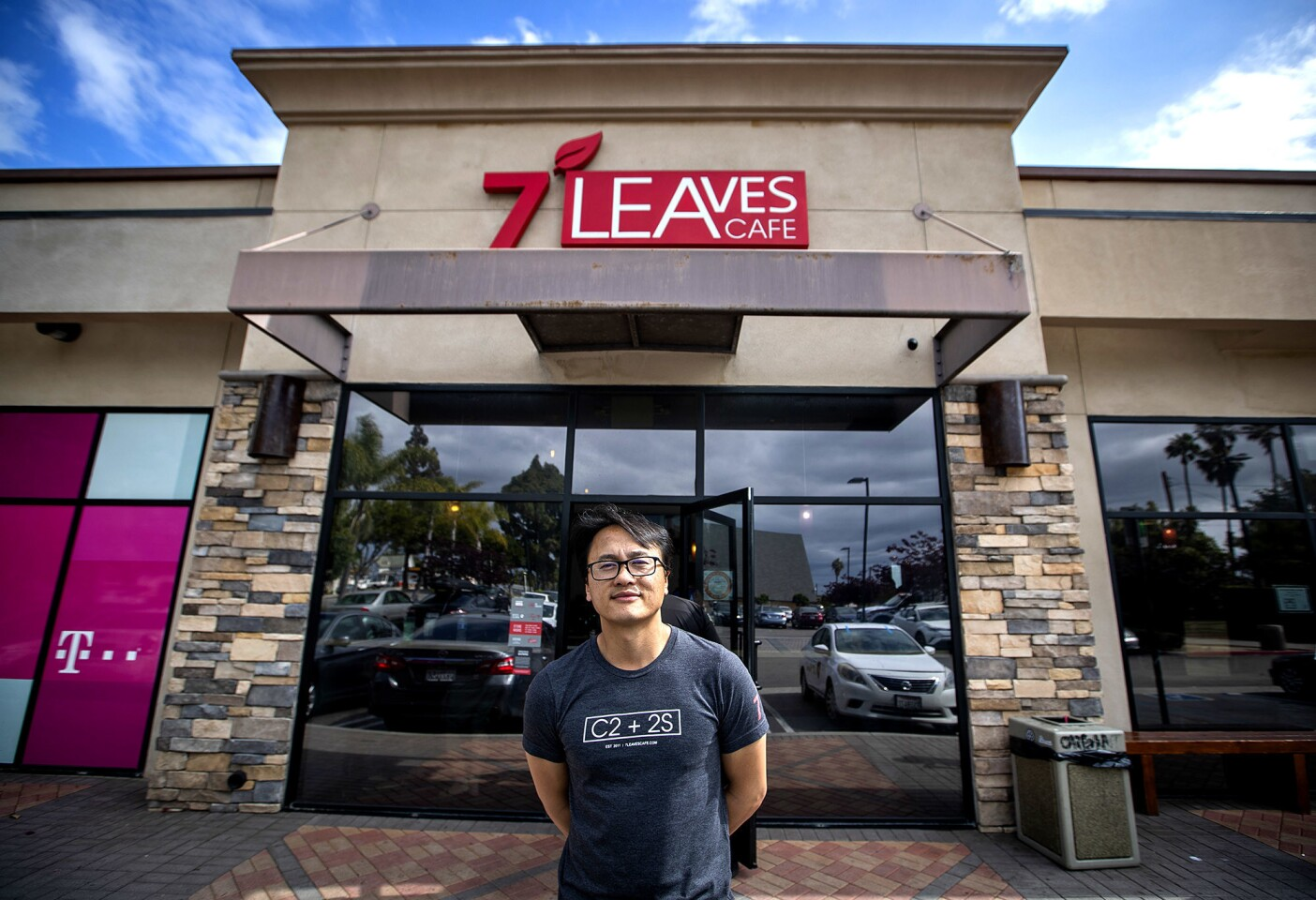 Son Nguyen, aka Sonny, stands outside 7 Leaves Cafe in Garden Grove, the second coffee shop the four brothers opened in Orange County.