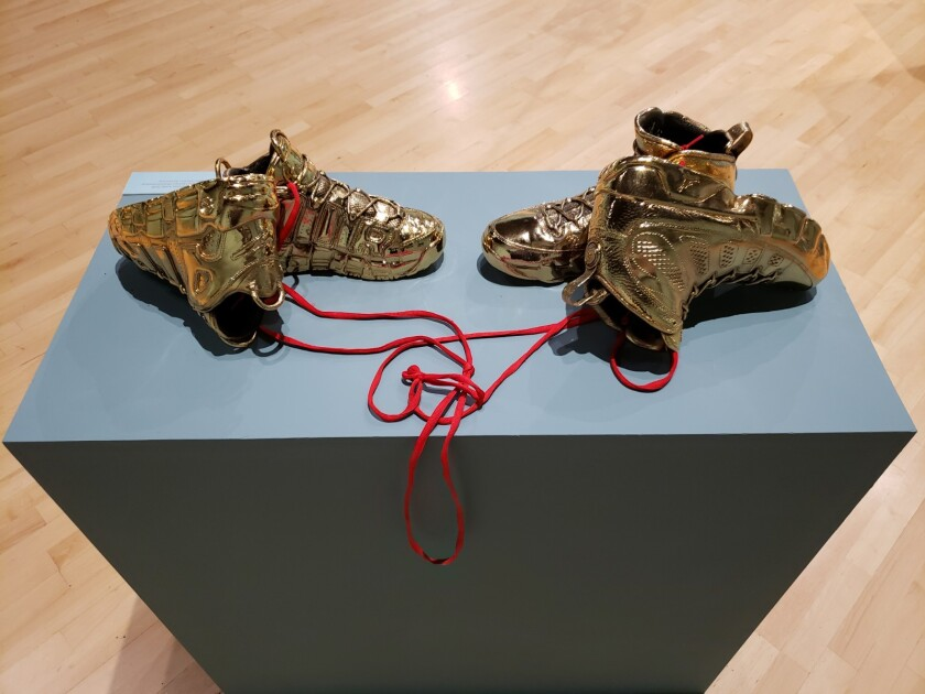 """Kendell Carter, """"Effigy for a New Normalcy, Love like Michael Loves Scottie,"""" 2018, gold-plated basketball shoes, shoe laces"""