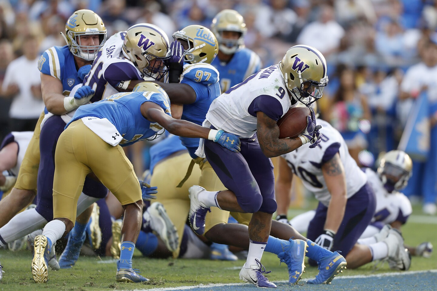 Washington tailback Myles Gaskin scores a touchdown against UCLA in the second quarter on Saturday at the Rose Bowl.