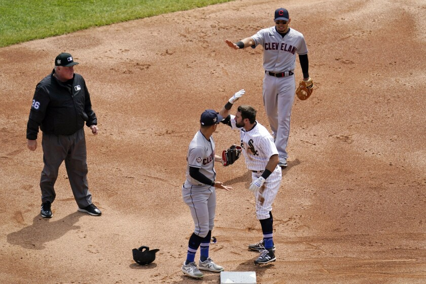 Chicago White Sox's Adam Eaton, bottom right, and Cleveland Indians shortstop Andres Gimenez, second from left, get into an argument at second base as Indians second baseman Cesar Hernandez, top right, watches during the first inning of a baseball game in Chicago, Thursday, April 15, 2021. (AP Photo/Nam Y. Huh)
