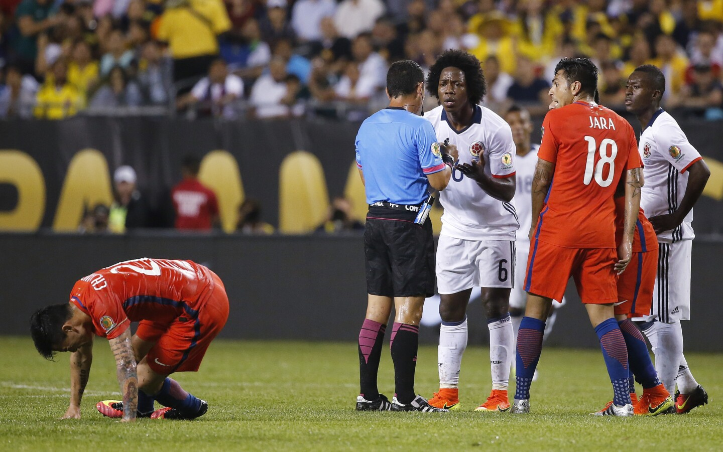 Colombia's Carlos Sanchez (6) appeals to referee Joel Aguilar after receiving the first of two yellow cards during a Copa America Centenario semifinal soccer match against Chile at Soldier Field in Chicago, Wednesday, June 22, 2016. (AP Photo/Charles Rex Arbogast)