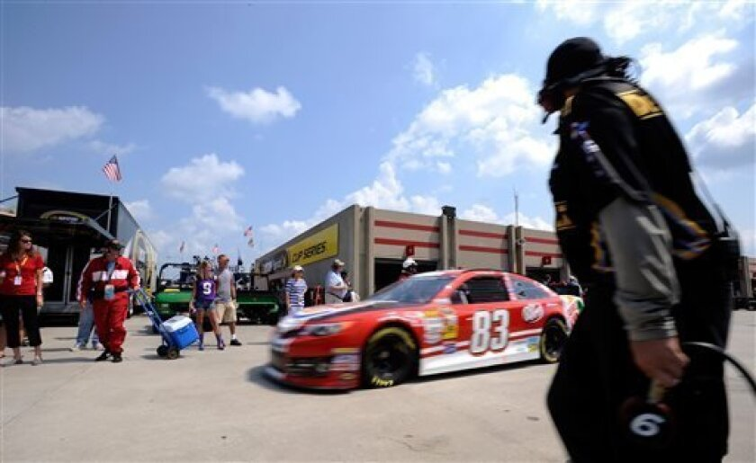 David Reutimann drives out of the garage area during practice for Sunday's NASCAR Sprint Cup Series auto race at Atlanta Motor Speedway, Saturday, Aug. 31, 2013 in Hampton, Ga. (AP Photo/David Tulis)