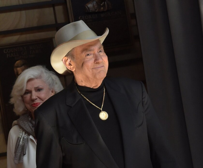 Jim Ed Brown, front, and his sister Bonnie Brown attend the Country Music Hall of Fame ceremonies in 2011.