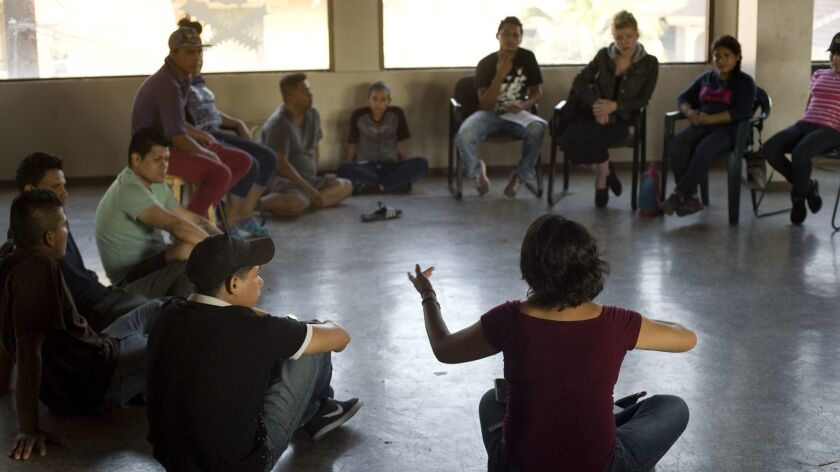 A member of the organization, Pueblo Sin Fronteras, speaks during a meeting with immigrants and imm