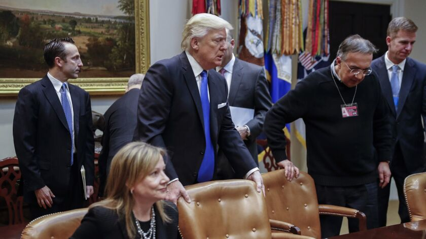 President Donald Trump, center, with General Motors CEO Mary Barra, left, and Fiat Chrysler CEO Sergio Marchionne, second from right, during a White House meeting with auto executives in 2017.