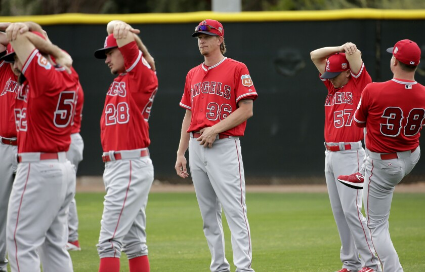Angels starting pitcher Jered Weaver (36) watches during stretching drills during spring training baseball workouts.