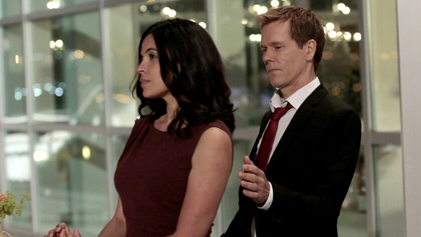 """Zuleikha Robinson and Kevin Bacon in """"The Following"""" on Fox."""