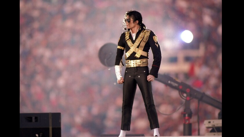 Michael Jackson performs in 1993 during halftime at Super Bowl XXVII between the Dallas Cowboys and the Buffalo Bills at the Rose Bowl in Pasadena.