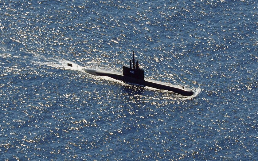 Indonesian Navy submarine KRI Alugoro sails during a search for KRI Nanggala, another submarine that went missing Saturday