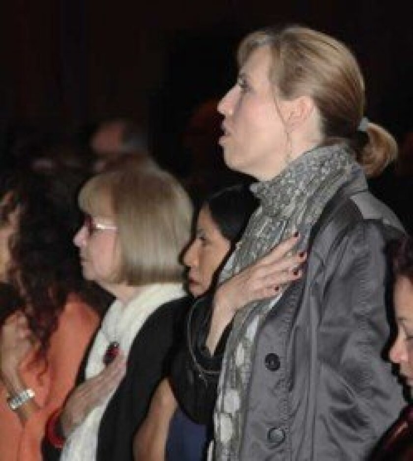 "Attendees showed solidarity with Israel and the U.S. during the ""National Anthem."""