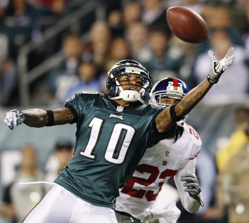 DeSean Jackson, a Philadelphia Eagles wide receiver last season, reaches for a pass as New York Giants cornerback Corey Webster defends.